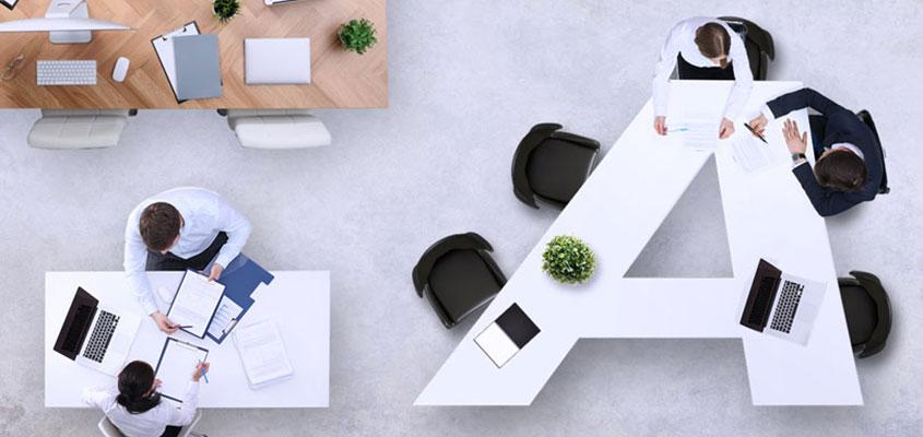 Letter-shaped desk design solution to make creative atmosphere at workspace