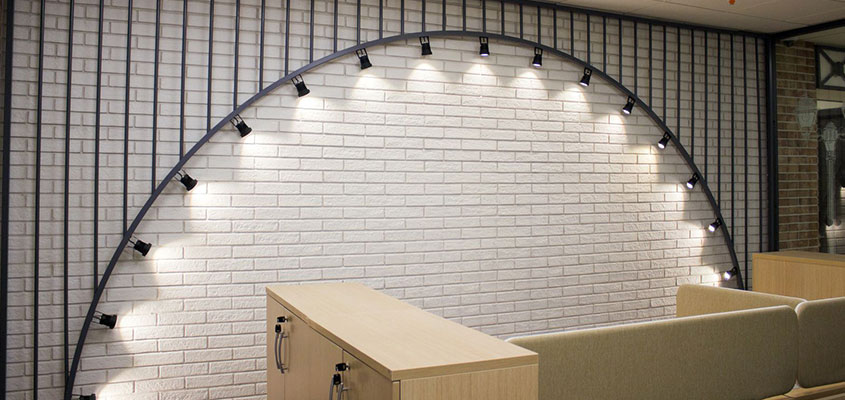 Arch shaped lighting design idea for office space