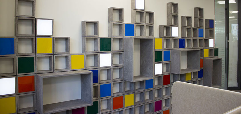 Multicolored wooden box structure for office wall design inspiration
