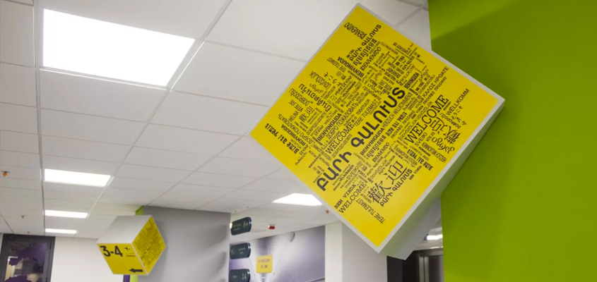 Multilingual hanging sign for corporate office interior design