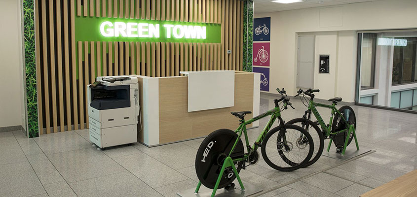 Office entry design idea with a bicycle parking for highlighting the company uniqueness