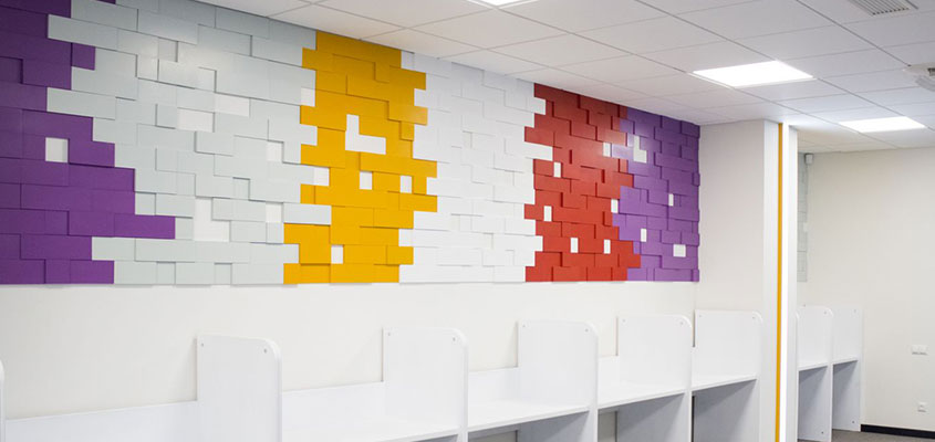 Puzzle shaped office wall design for hang out corner