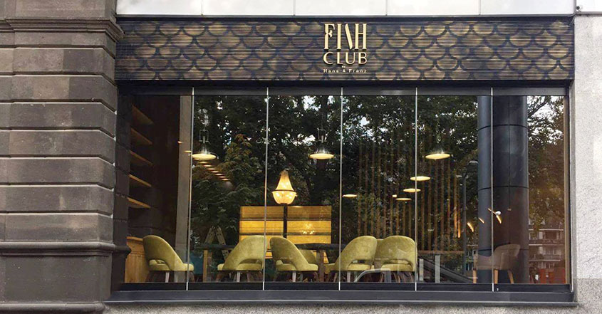 Fish Club restaurant space design with yellow furniture