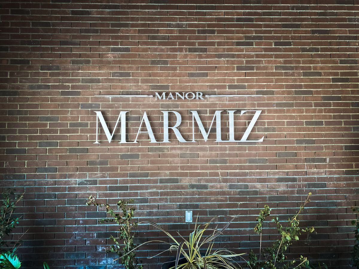 Manor Marmiz 3d sign letters displaying the company name made of brushed aluminum