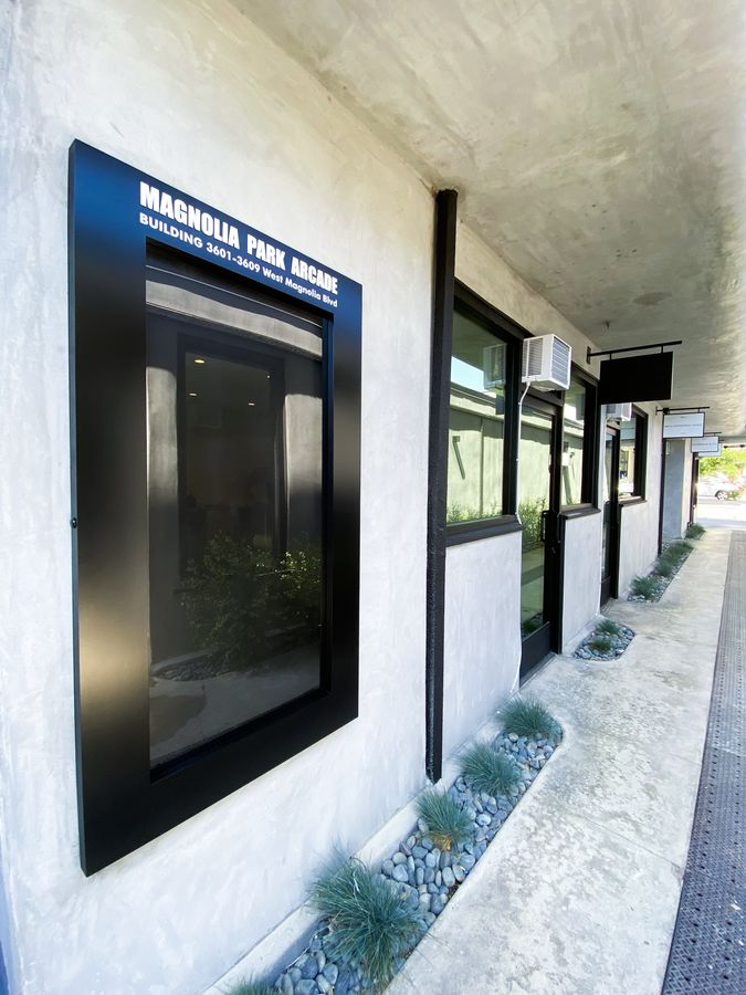 Wall-mounted building sign