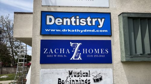 Zacha Homes plywood sign