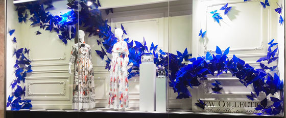 artful storefront display with acrylic blue butterflies