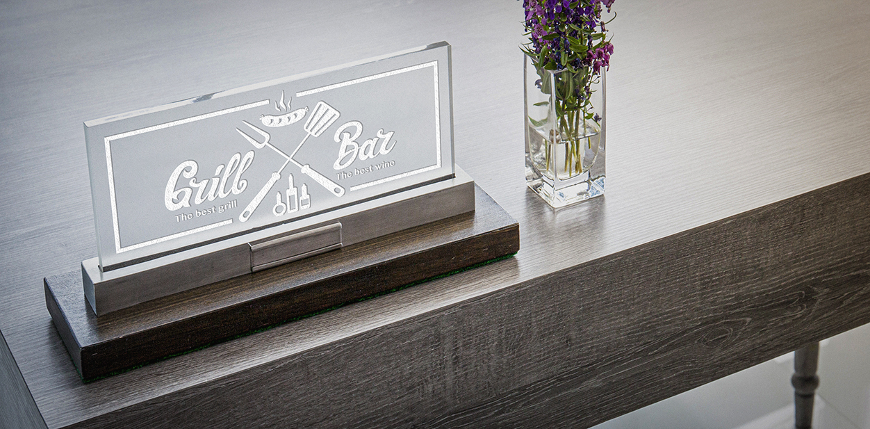 Laser engraving decor idea on acrylic displaying the brand name and logo