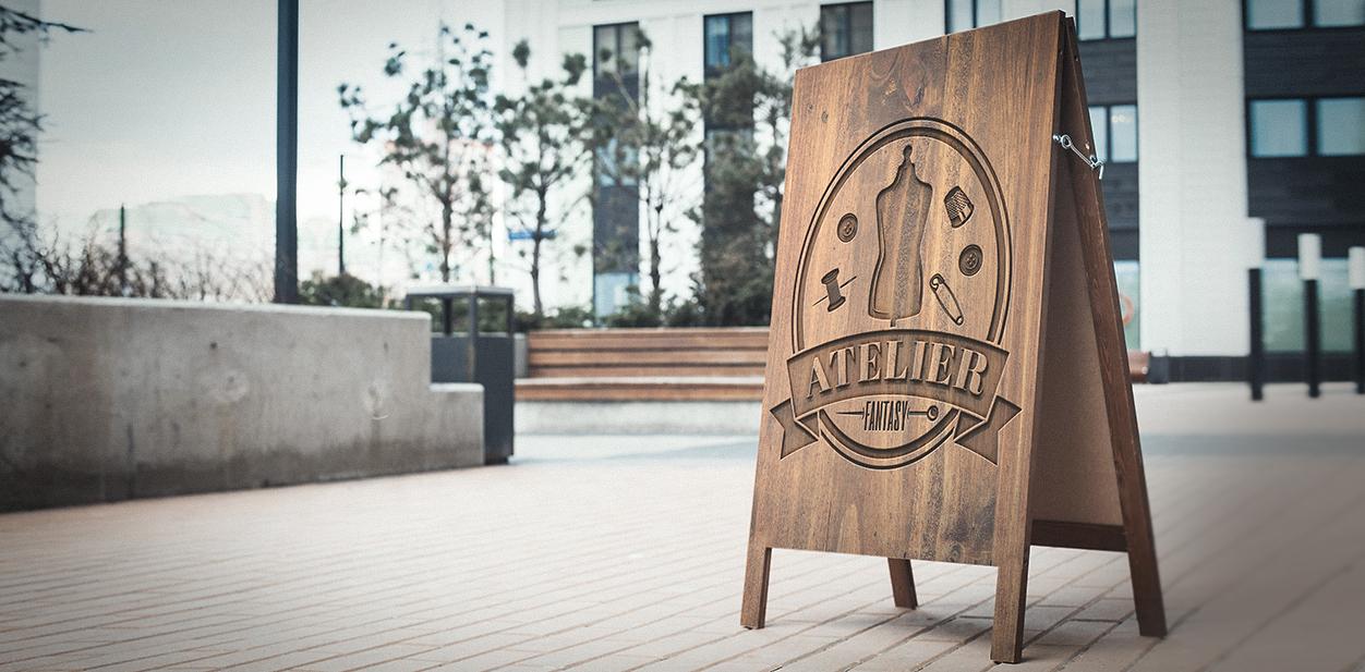 Atelier laser cut wood project on a sandwich board example