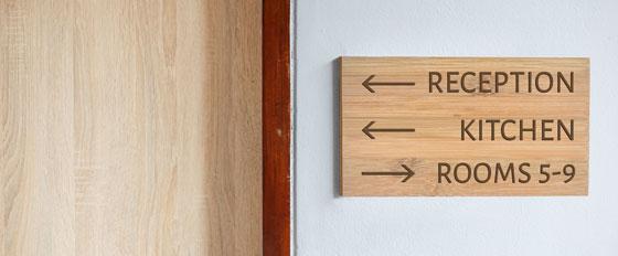 interior wayfiniding wooden board