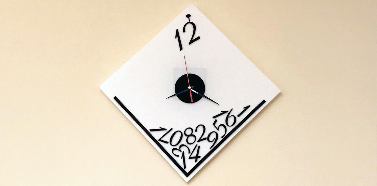 Decorative wall clock creative laser cut idea displayed on the wall