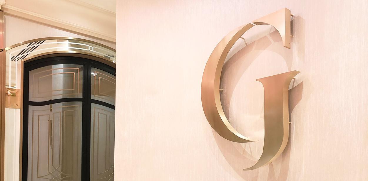 Golden G letter luxurious laser cut concept