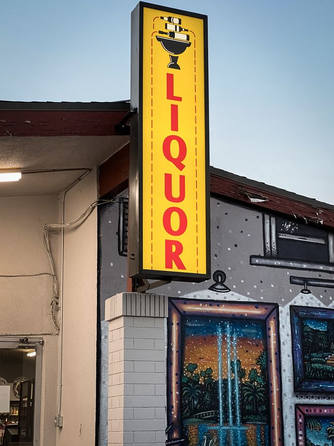 The Liquor Fountain store light box sign in a large size made of aluminum and acrylic for business branding and visibility