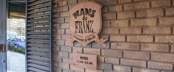 Hans & Franz metallic branded wall plaque