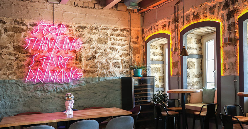 restaurant bar design with neon sign quote
