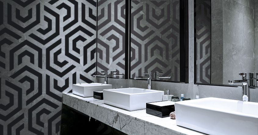 restaurant restroom design with black and white geometric wallpaper