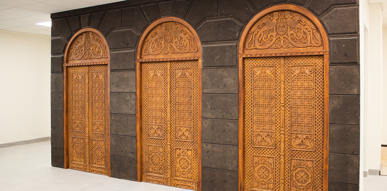 Artful wood engraving idea for doors in an ancient style