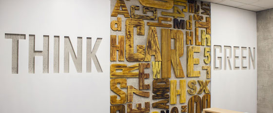 Think Green wooden letters design on a wall