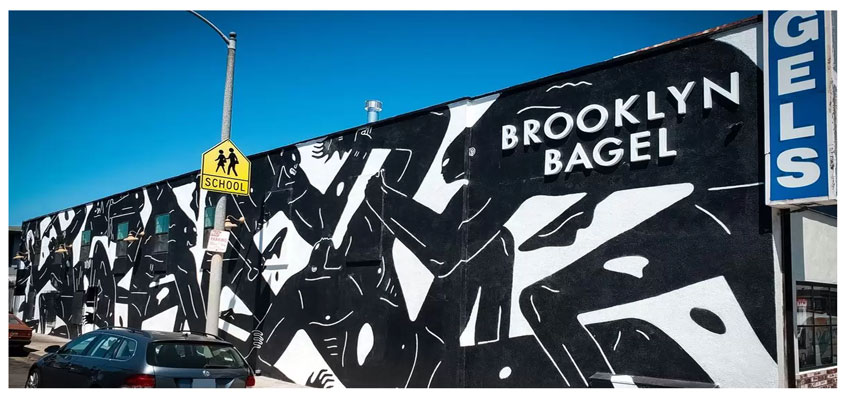 Brooklyn Bagel cool exterior design with black and white human wall mural