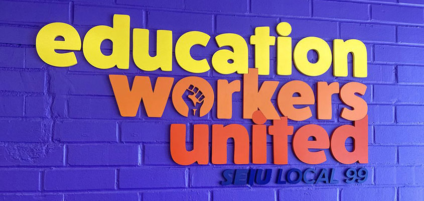 Colorful sign design elements from Education Workers United sign example