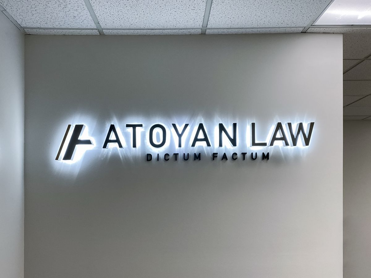 Atoyan Law backlit letters