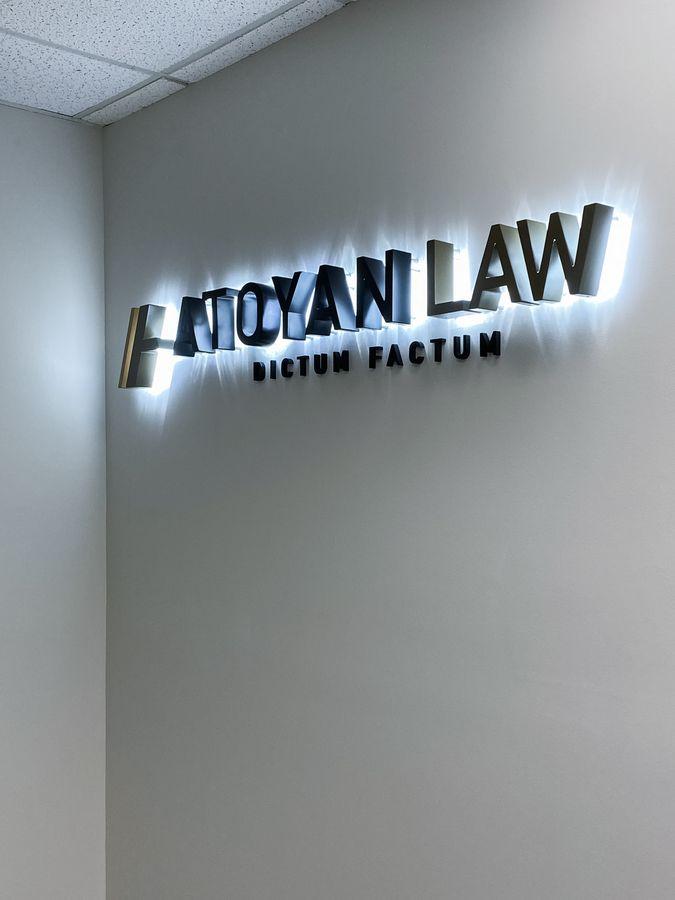 Atoyan Law reverse lit letters