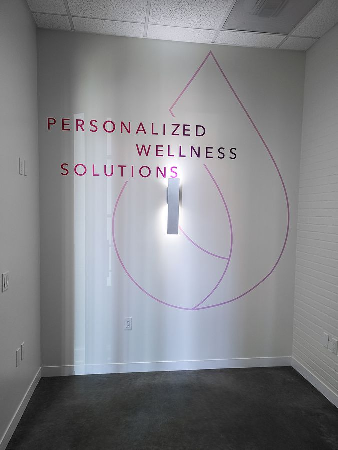 The Solutions TM custom interior wall sign with lettering made of opaque vinyl for branding