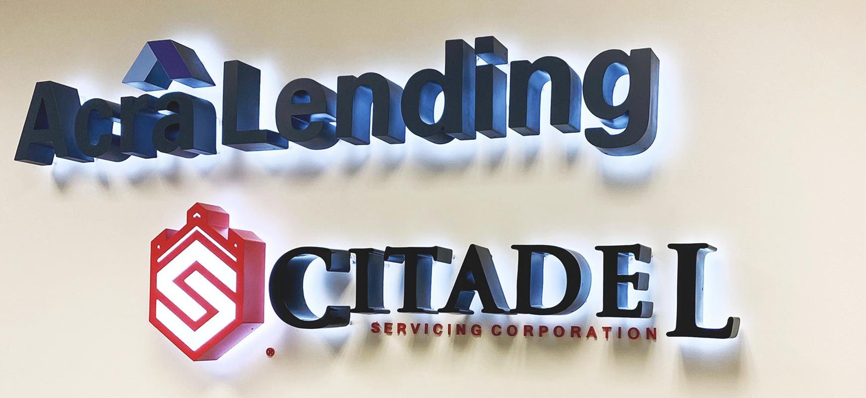 Acra Lending backlit channel letters made of aluminum for office branding