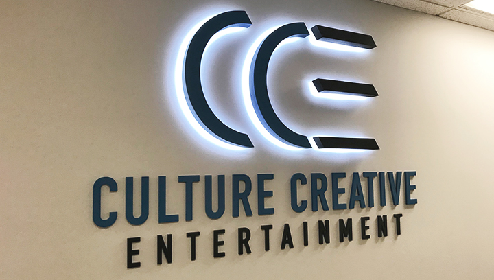 CCE standard backlit letters in dark blue made of aluminum and acrylic for office branding