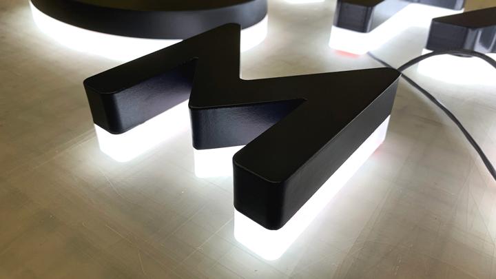 half side-lit halo letters