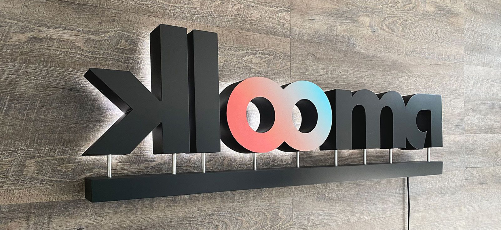 Klooma reverse channel letters made of aluminum and acrylic for office branding
