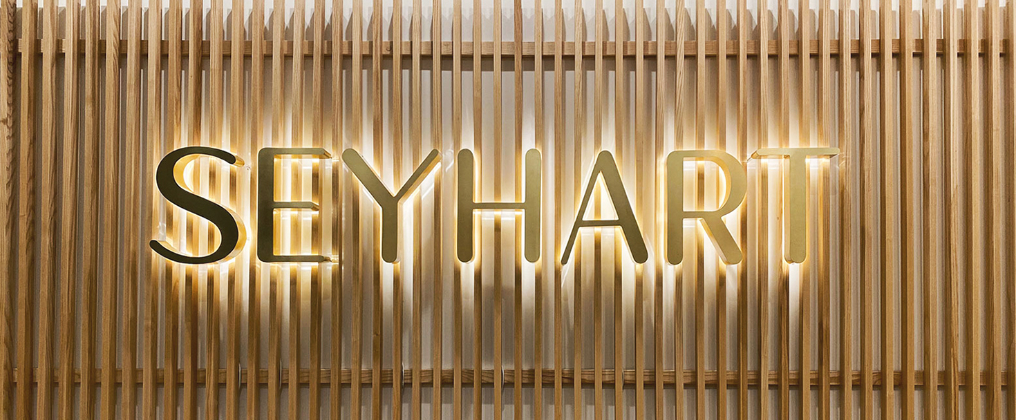 Seyhart reverse channel letters in golden color made of aluminum and acrylic