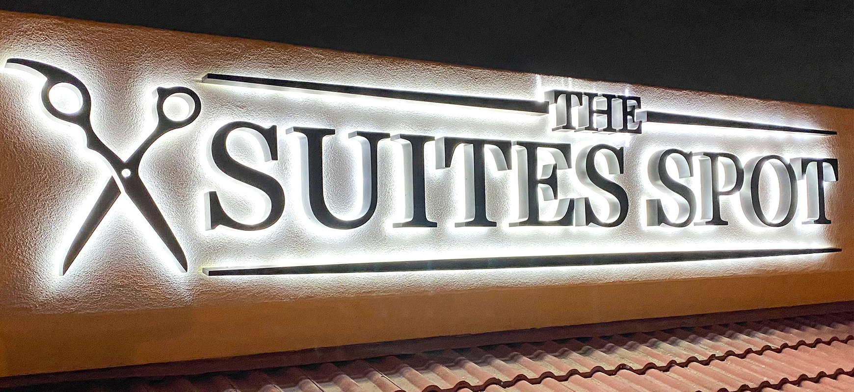The Suites Spot backlit letter sign in a custom style made of aluminum and acrylic