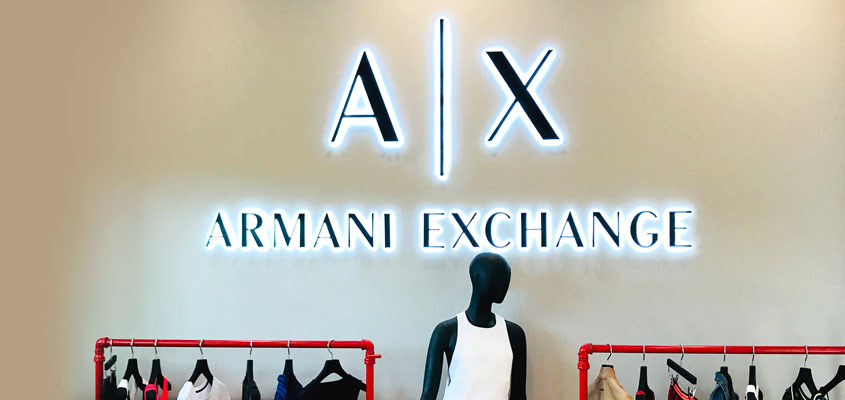 Branded signage design idea from Armani's interior design