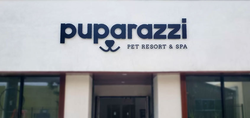 Wall-mounted outdoor signage design idea from Puparazzi Pet Resort & Spa