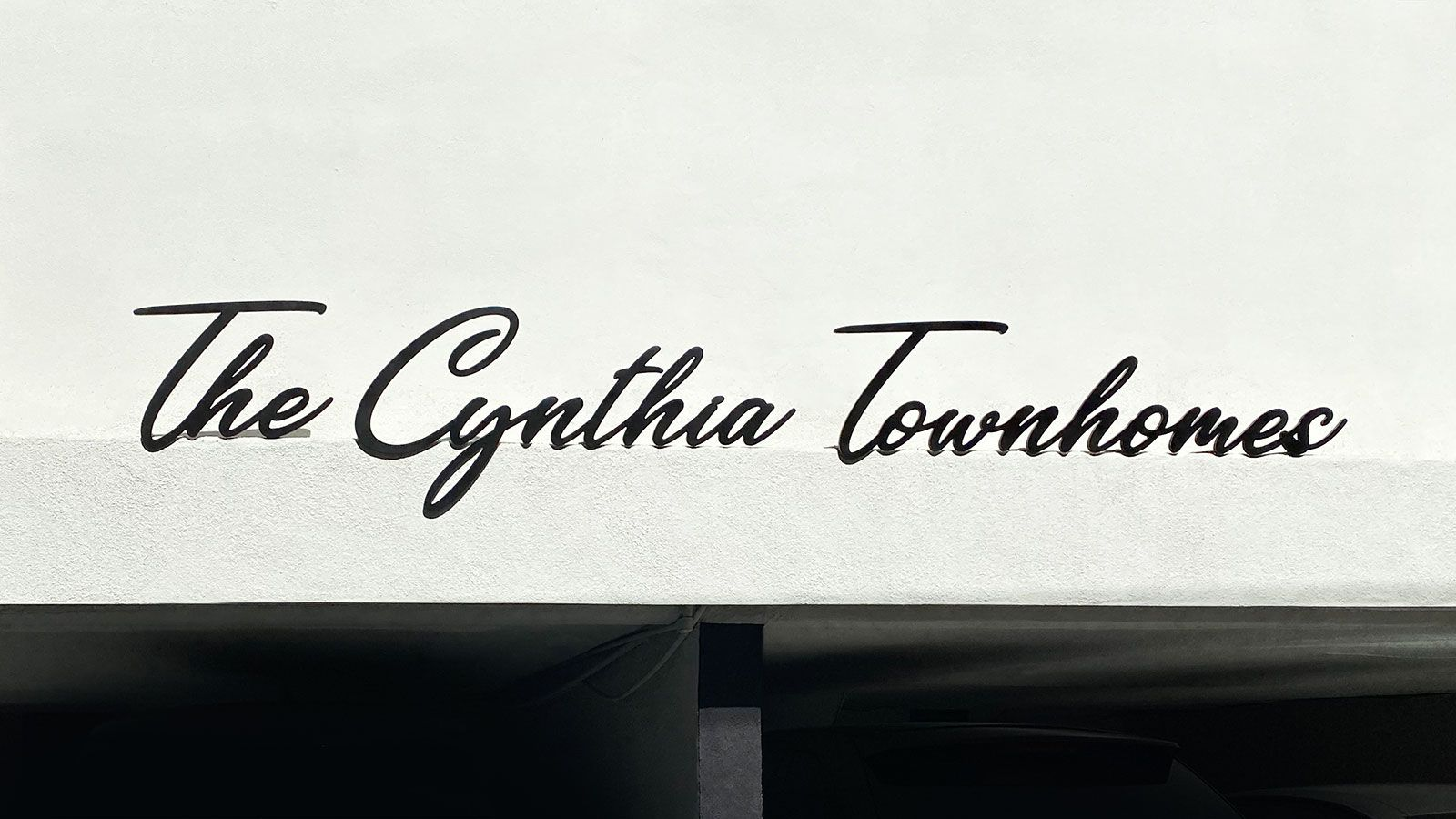 The Cynthia Townhomes 3d sign letters with an elegant font painted in black made of aluminum