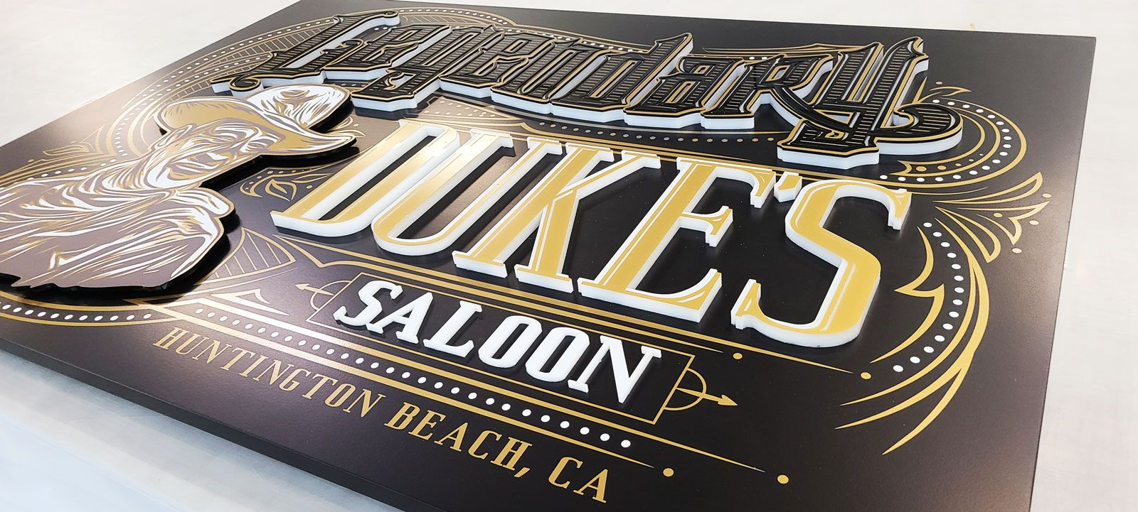 Duke's saloon push through sign