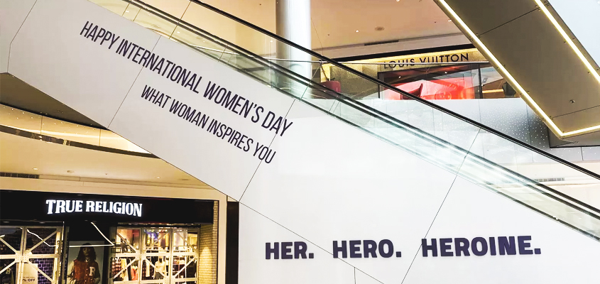 Image showing 'Her. Hero. Heroine' sign as a corporate branding solution