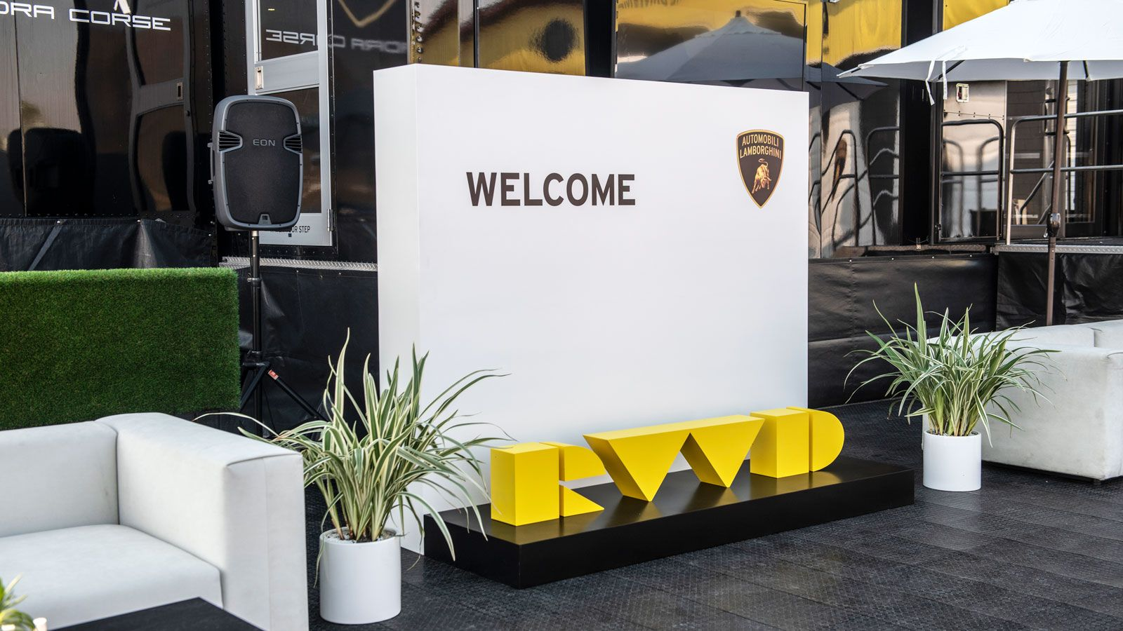 Lamborghini RWD 3d sign letters with a stand painted in yellow and black colors made of aluminum and wood for event branding