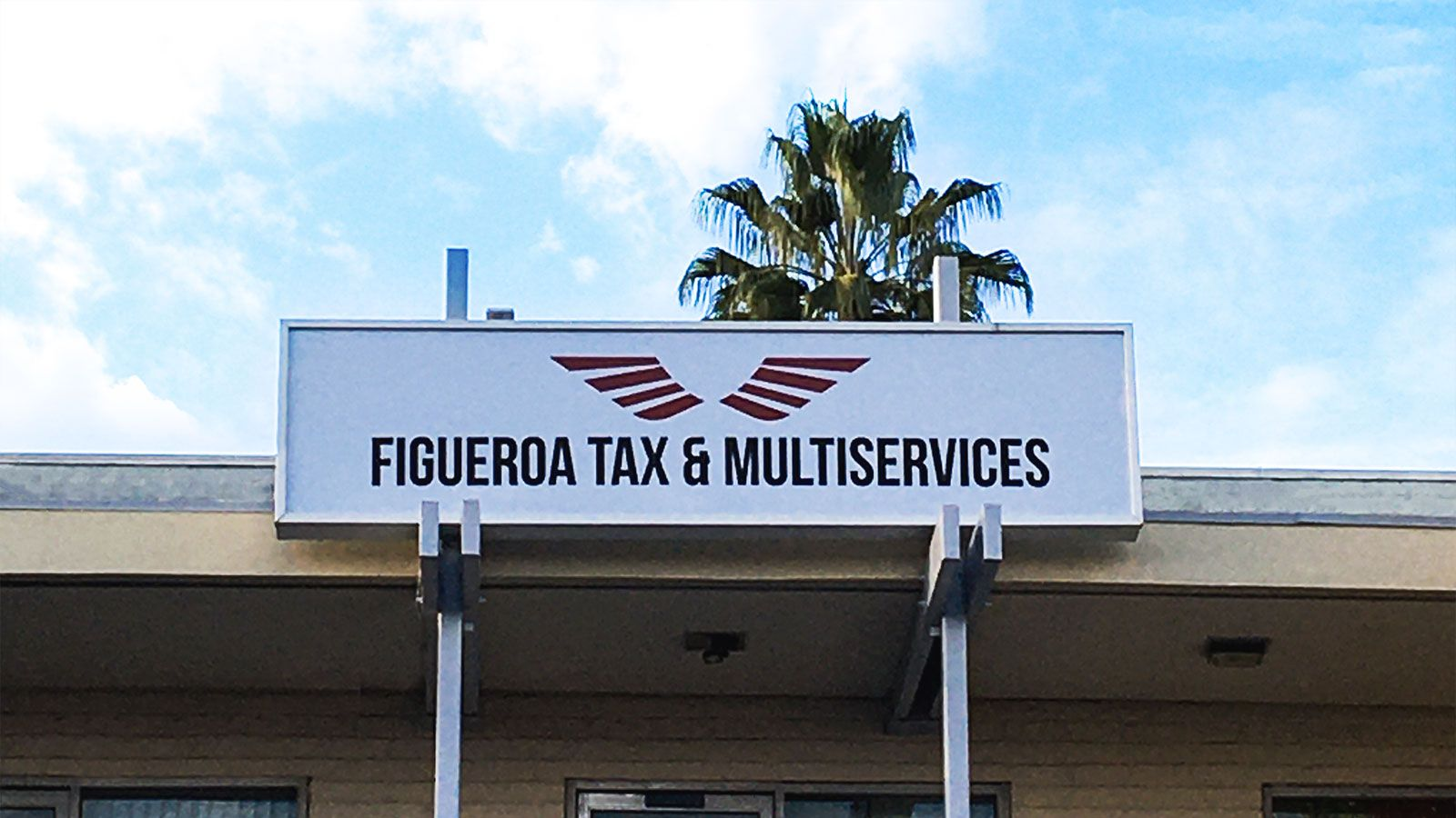 Figueroa Tax & Multiservices outdoor light box displaying the company name and logo made of aluminum and acrylic for branding
