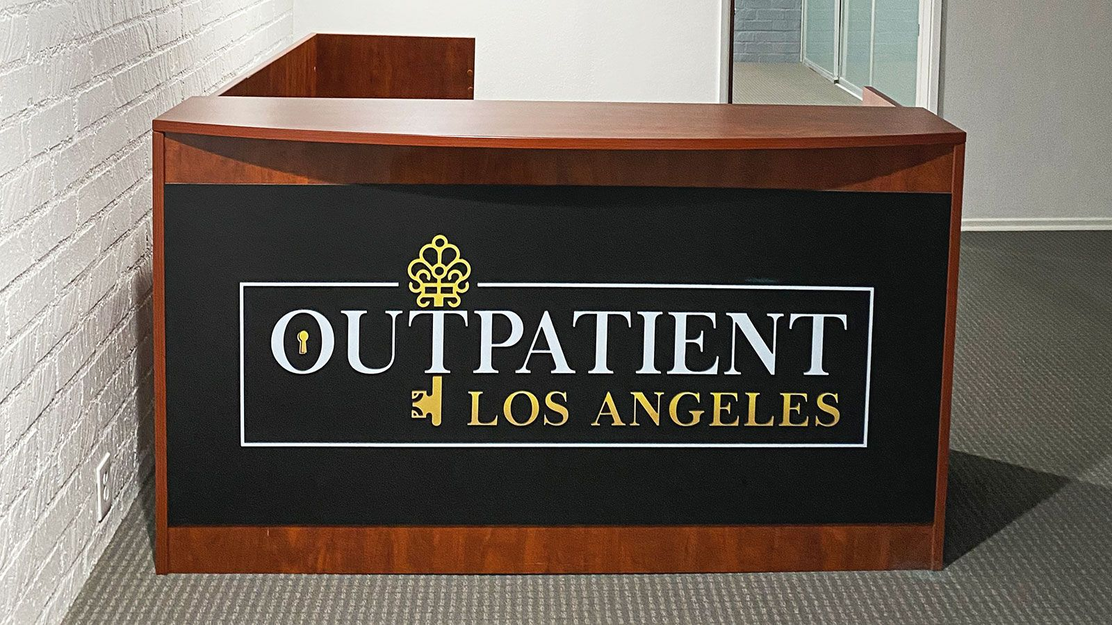 Outpatient Los Angeles reception desk logo sign made of PVC for interior branding