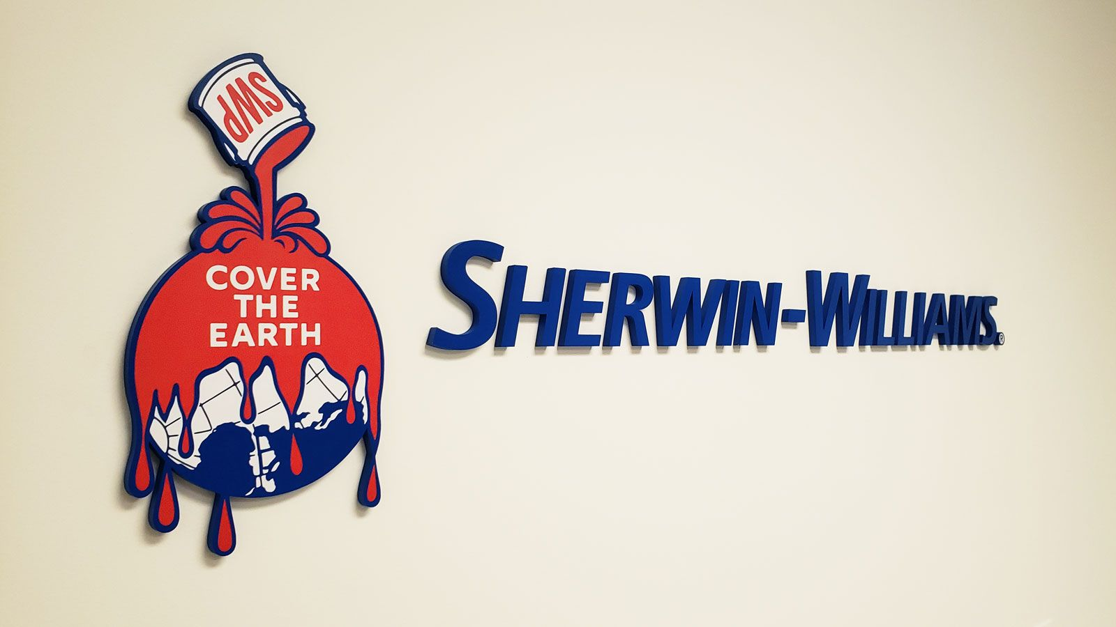 Sherwin-Williams 3d acrylic letters and logo sign painted in blue and red colors made of acrylic for office interior branding