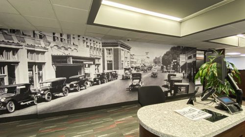 custom interior wall sign with retro images of a city made of opaque vinyl for office branding