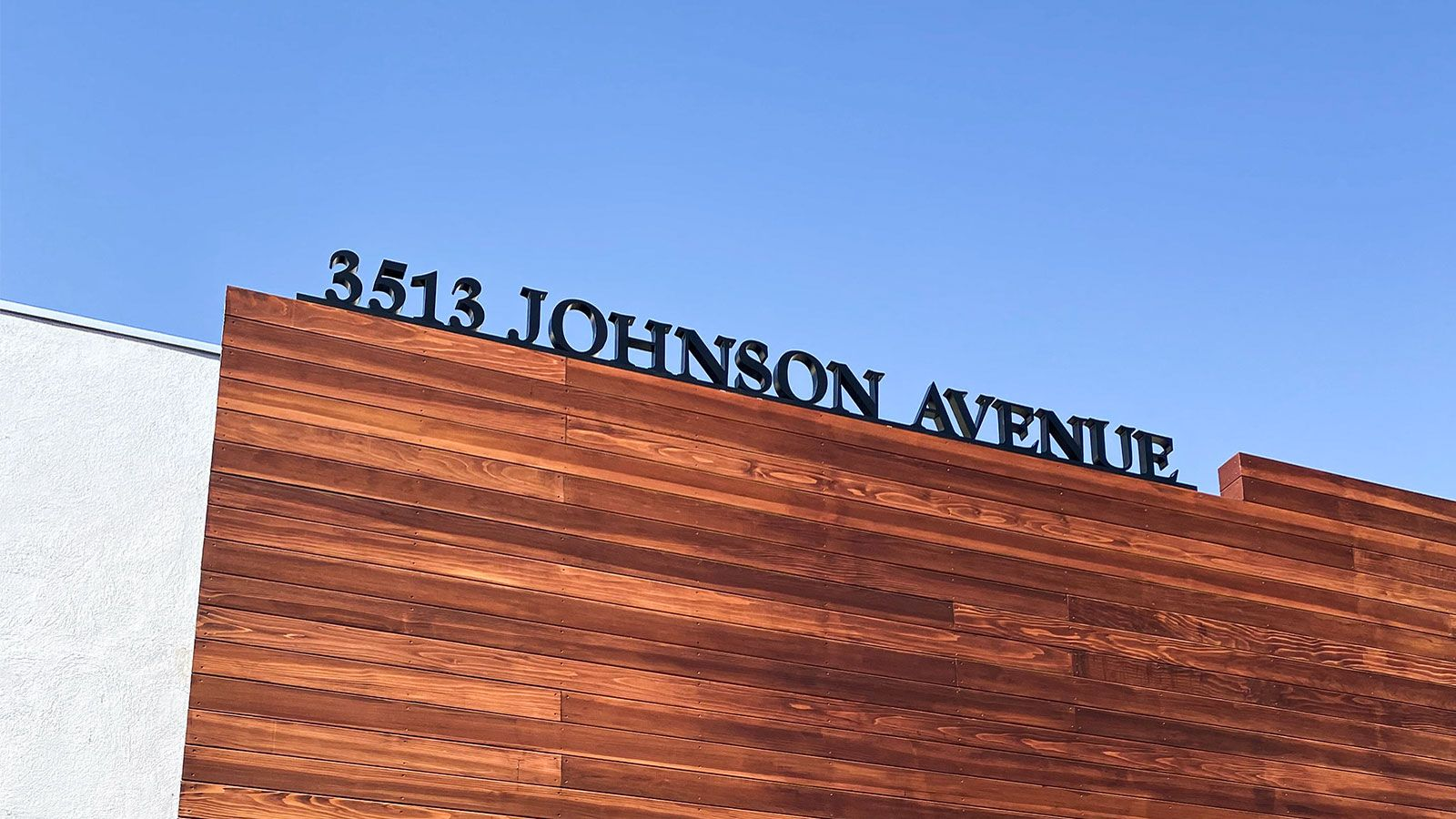 Johnson Avenue 3d acrylic letters and numbers in a large size on the rooftop for displaying the business address