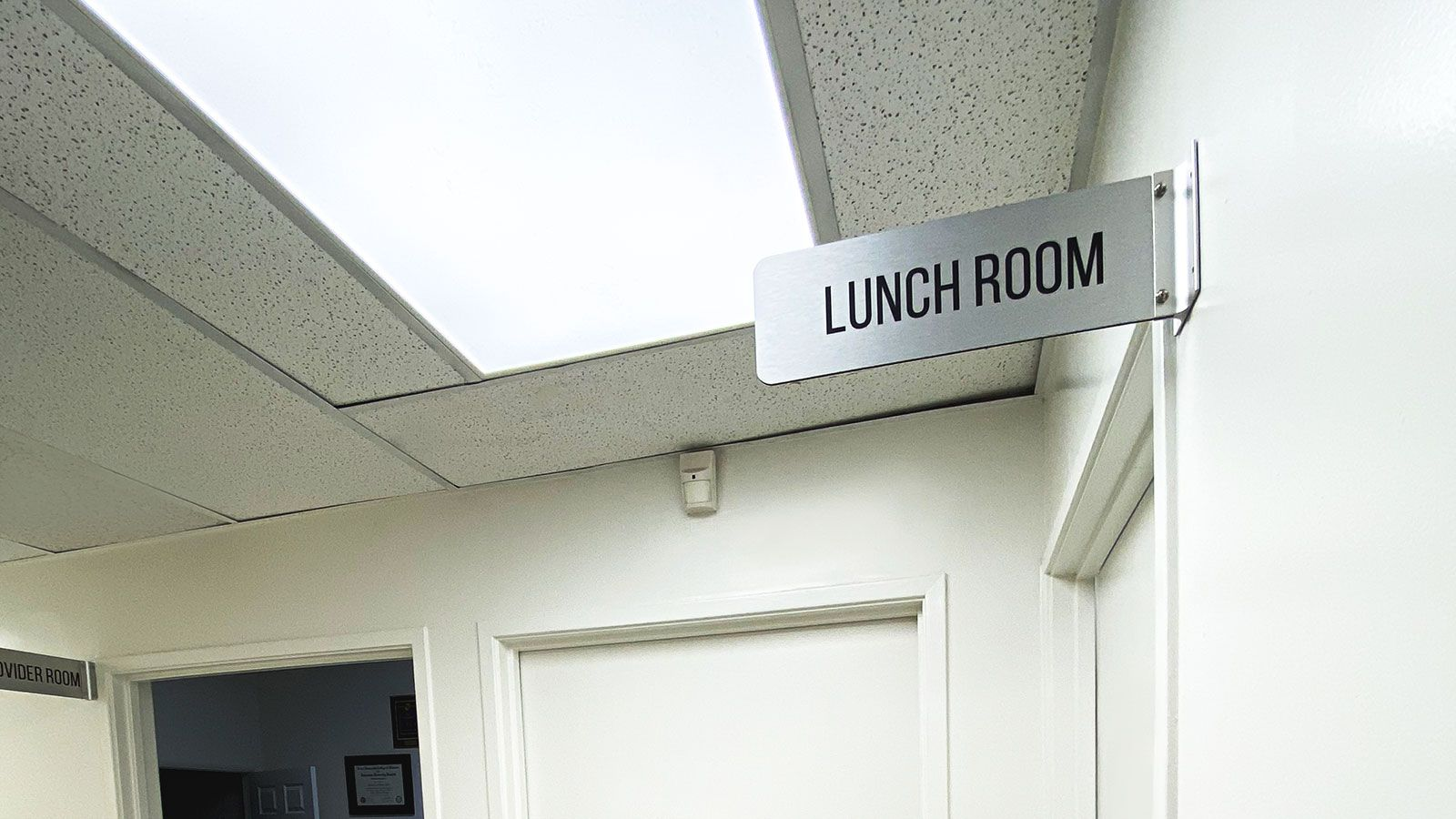 wall-blade brushed aluminum sign