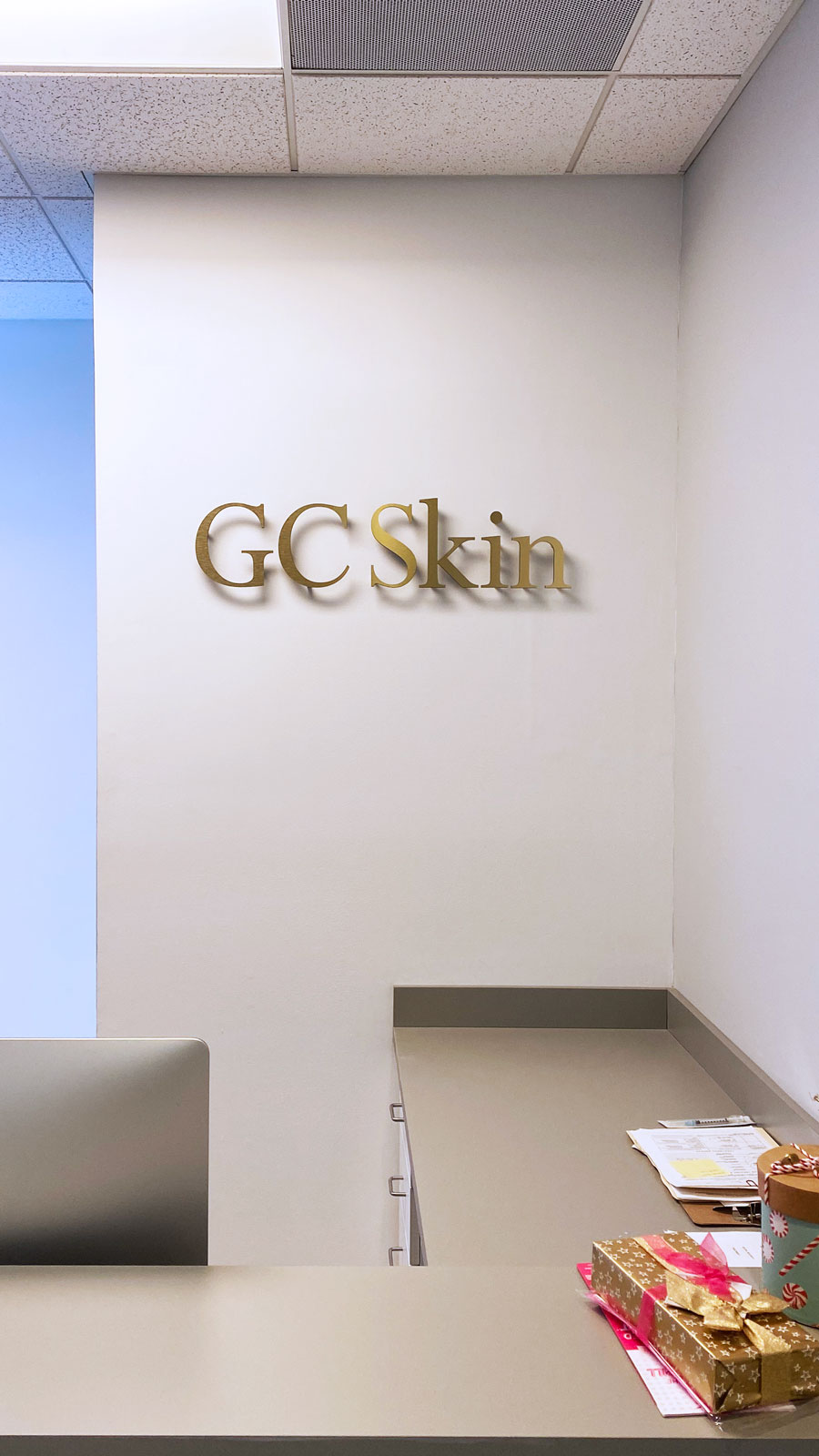 GC Skin office interior pin-mounted 3D letters