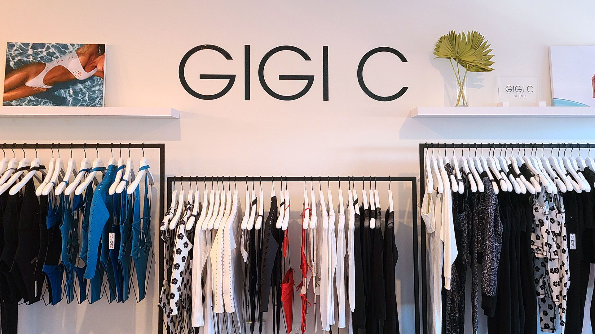Gigi C custom interior wall lettering signage displaying the name of the company made of opaque vinyl for store branding