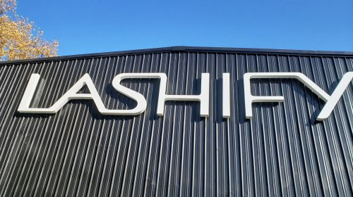 Lashify illuminated 3d sign in big size with the brand name made of acrylic and aluminum