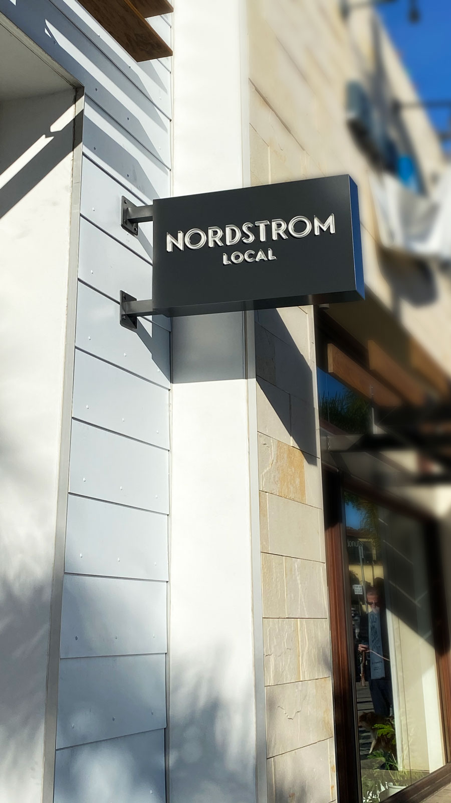 Nordstrom Local wall-blade lightbox sign