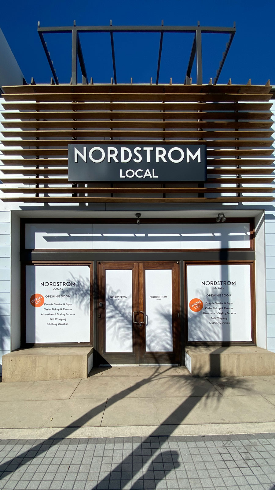 Nordstrom Local window decals and push through sign